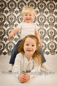 Won't be long before he doesn't need a stool to help him 'tackle' his sister!